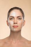 Beautiful girl in spa with cosmetic cream on her Royalty Free Stock Images