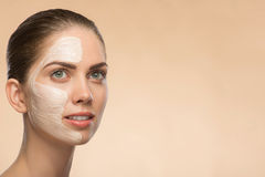 Beautiful girl in spa with cosmetic cream on her Royalty Free Stock Photography