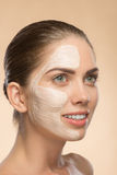 Beautiful girl in spa with cosmetic cream on her Stock Photography