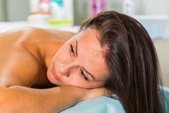 Beautiful girl at spa procedures royalty free stock photos