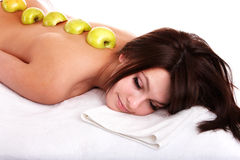 Beautiful girl on spa resort. Fruit massage. Stock Images