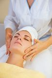 Beautiful girl in spa salon Stock Image