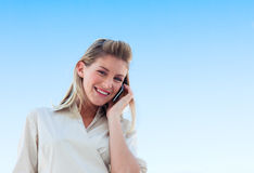 Beautiful girl speaking on phone. Beautiful blonde girl speaking on phone Royalty Free Stock Image