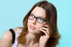 The beautiful girl speaks with blue eyes by phone Royalty Free Stock Photo