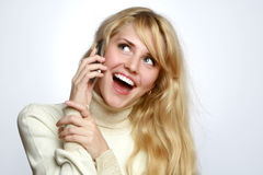 Beautiful girl speaks on a mobile telephone Stock Photos