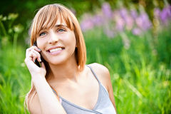 Beautiful girl speaks by phone Royalty Free Stock Photo