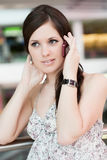 Beautiful girl speaks by phone Royalty Free Stock Photography