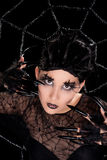 Beautiful girl with spider makeup Stock Photos