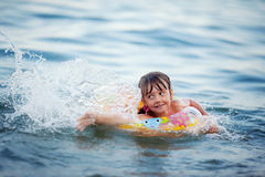 Beautiful girl splashing in the sea Stock Photo