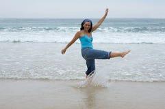 Beautiful girl splashing water Stock Images