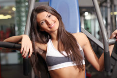 The beautiful girl in sports club Royalty Free Stock Photo