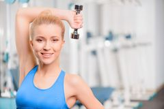 Beautiful girl in sports club Stock Photography
