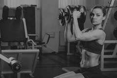 Beautiful girl in a sports gym stock photo