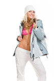 Beautiful girl in sports jacket and white hat Stock Photography