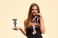 Beautiful girl and sports medals. Sports champion. Awards for sporting achievements. Beautiful girl and sports medals. Sports champion. Awards for sporting Royalty Free Stock Photos