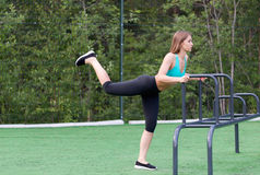 Beautiful girl in sportswear on the playground doing fitness. Stock Image