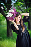 Beautiful girl in spring with a bouquet of lilacs.  Stock Photography