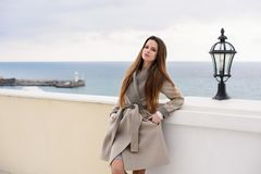 Woman in coat, outdoor. Beautiful girl in spring day outdoors. Girl with long hair royalty free stock images