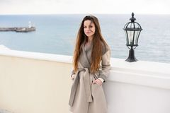 Woman in coat, outdoor. Beautiful girl in spring day outdoors. Girl with long hair royalty free stock image