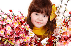 Beautiful girl with spring flower and butterfly. Royalty Free Stock Images