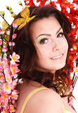 Beautiful girl with spring flower and butterfly. Royalty Free Stock Photos