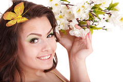 Beautiful girl with spring flower and butterfly. Stock Image