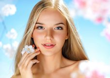 Beautiful girl with spring flowers. Beauty & Skin care. Spring Royalty Free Stock Photos