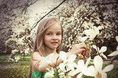 Beautiful Girl with Spring Flowers Stock Photo