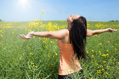 Beautiful girl at spring. On a meadow with yellow flowers Stock Images