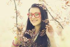 Beautiful girl in spring park Stock Photos