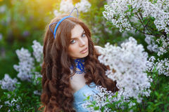 Beautiful girl in spring park Lilac.  Royalty Free Stock Photography