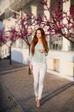 Beautiful girl in spring sunny day outdoors. Girl with long hair royalty free stock image