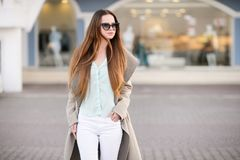 Beautiful girl in spring sunny day outdoors. Girl with long hair stock photo