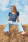 Beautiful girl and stack hay Royalty Free Stock Photo