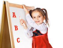 Beautiful girl standing at the blackboard royalty free stock photography