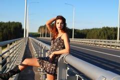 Beautiful girl. Standing on the bridge stock photos