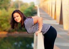 Beautiful girl standing on the bridge Stock Image