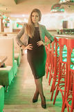 Beautiful girl standing in cafe Royalty Free Stock Image