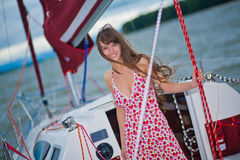 Beautiful girl standing on the deck Royalty Free Stock Photo