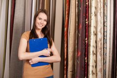 Beautiful girl standing in dry goods store. Royalty Free Stock Image