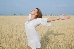 Beautiful girl standing in field Stock Photos