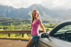 Beautiful girl standing by the Ford Mustang GT stock photos