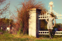 Beautiful girl standing at the gate Royalty Free Stock Photo