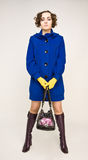 Beautiful girl standing with handbag Royalty Free Stock Photography
