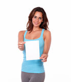 Beautiful girl standing and holding card Royalty Free Stock Photo