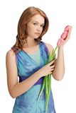 Beautiful girl standing holding tulips Stock Photos
