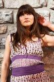 Beautiful girl standing near ancient brick wall Stock Photos