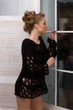 Beautiful girl standing near the window Stock Photo