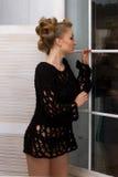 Beautiful girl standing near the window Stock Photo
