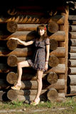 Beautiful girl standing near wooden house Royalty Free Stock Photo